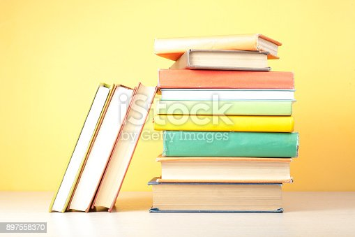 istock Stack of colorful books. Education background. Back to school. Copy space for text. 897558370