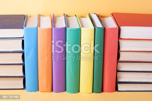 istock Stack of colorful books. Education background. Back to school. Copy 591797492