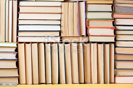 istock Stack of colorful books. Education background. Back to school. Copy 591798074