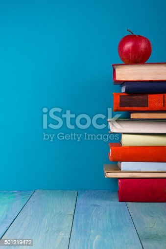 istock Stack of colorful books, grungy blue background, free copy space 501219472