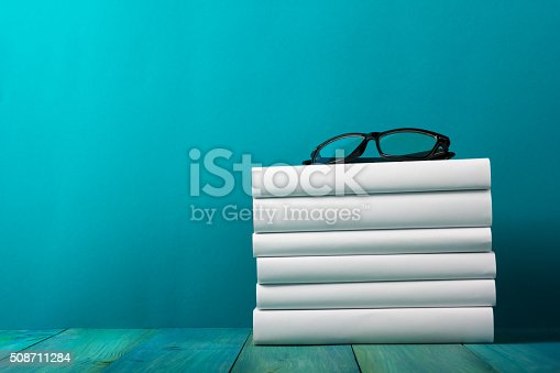 508711370 istock photo Stack of colorful books, grungy blue background, free copy space 508711284