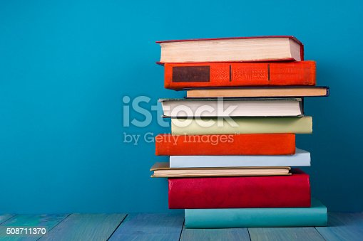 istock Stack of colorful books, grungy blue background, free copy space 508711370