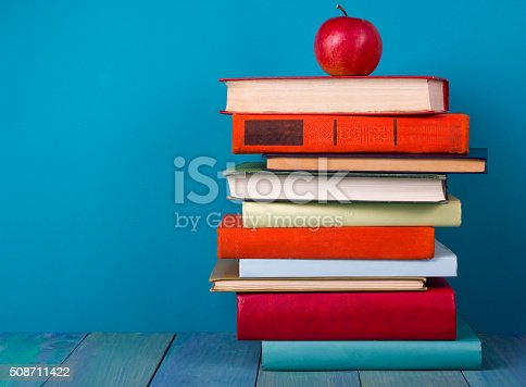 508711370 istock photo Stack of colorful books, grungy blue background, free copy space 508711422