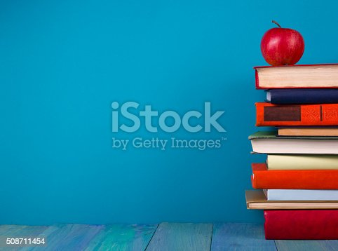 508711370 istock photo Stack of colorful books, grungy blue background, free copy space 508711454