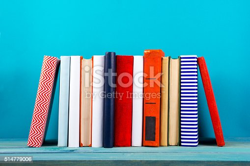 istock Stack of colorful books, grungy blue background, free copy space 514779006