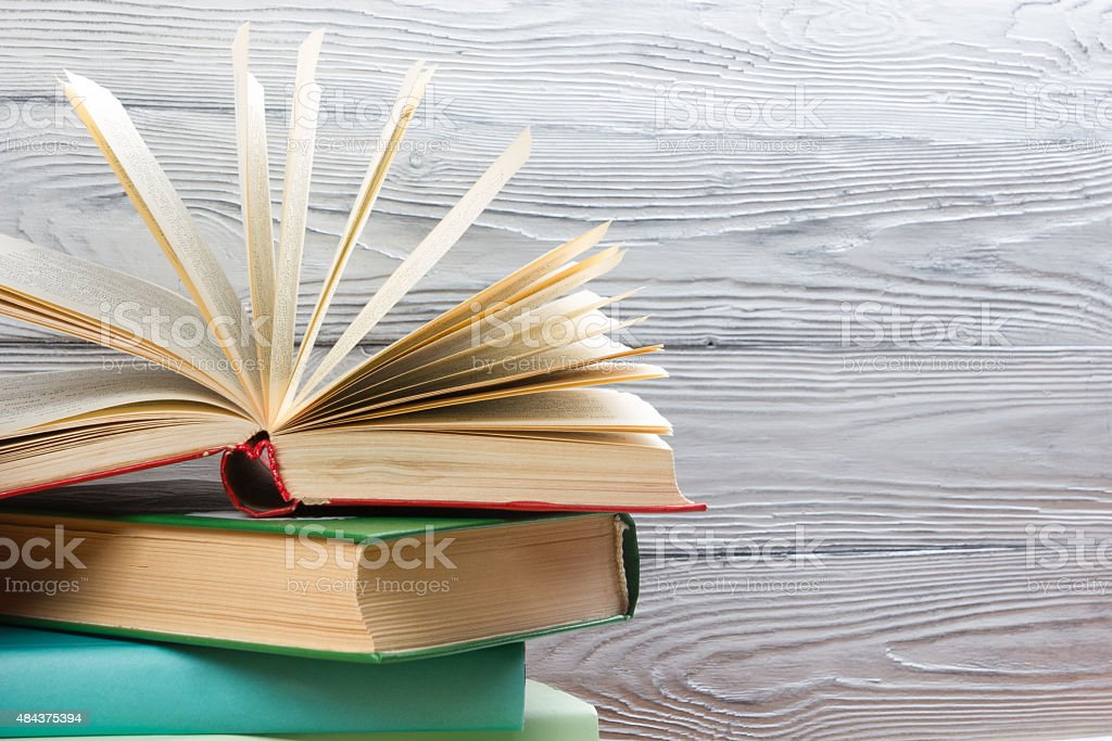 Stack of colorful books on wooden table. Back to school. stock photo