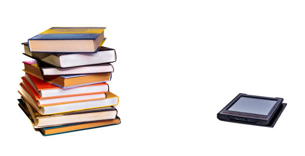Stack of colorful books with electronic book reader. Isolated on white stock photo