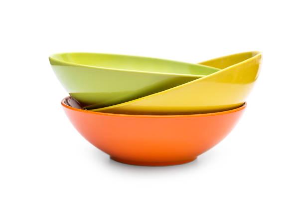 stack of colorful bowls on white. - naczynia stołowe zdjęcia i obrazy z banku zdjęć