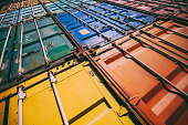Background detail of colorful cargo freights container stacks in shipping port