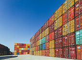 Background of colorful cargo freights container stacks in shipping port