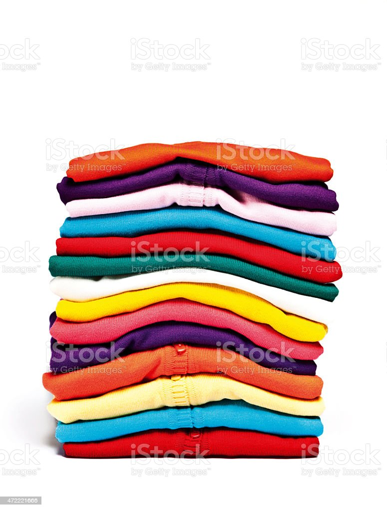A stack of colorful clothes on a white background stock photo