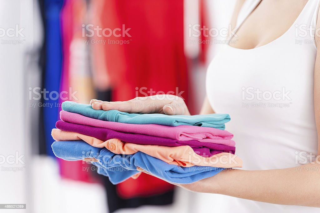 Stack of colorful clothes. stock photo