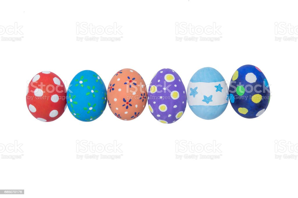 Stack of colorful handmade easter eggs isolated on white royalty-free stock photo