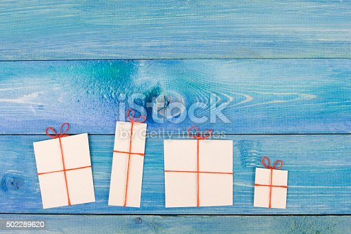 istock Stack of colorful hardback books, open book on blue background 502289620