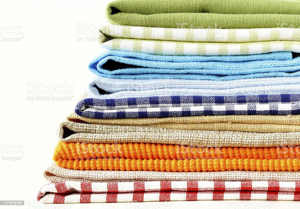 stack of colorful kitchen napkins on white background stock photo