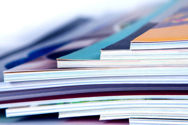 stack of colorful magazines , extreamly dof - publication stock pictures, royalty-free photos & images