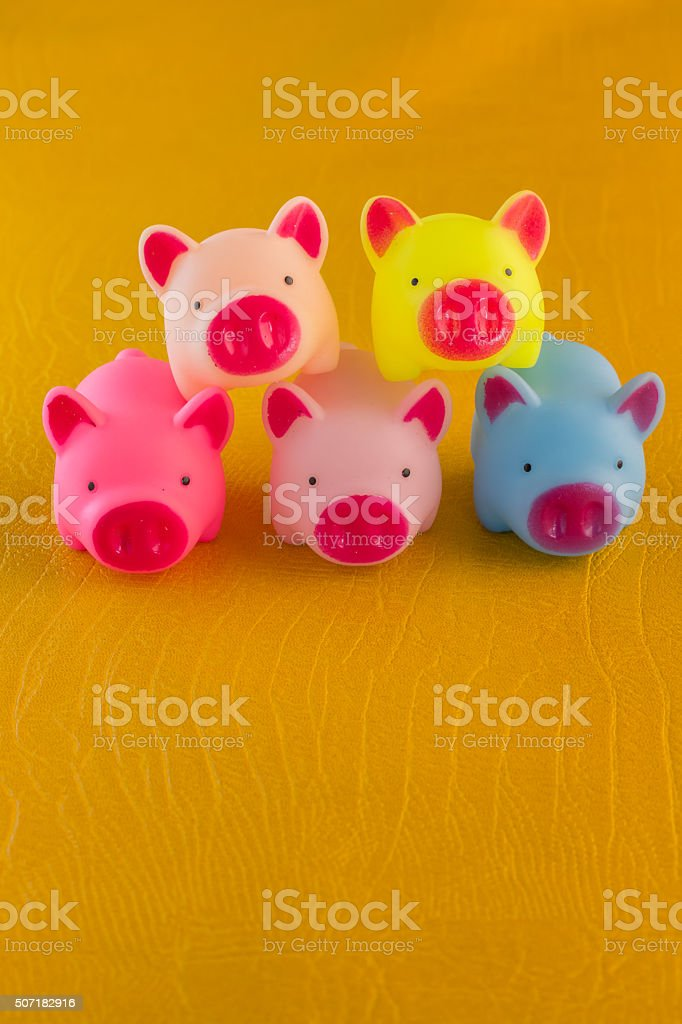 stack of colorful pig toy stock photo