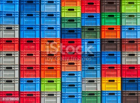 colorful plastic boxes stacked one upon the other