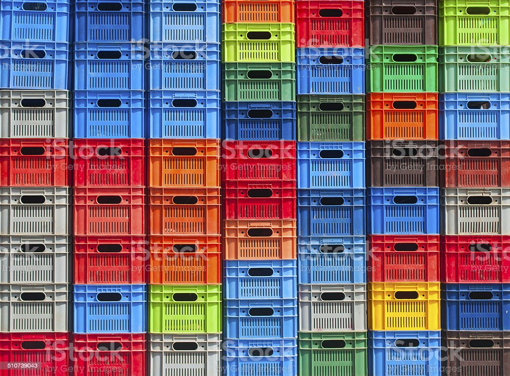 stack of colorful plastic boxes stock photo