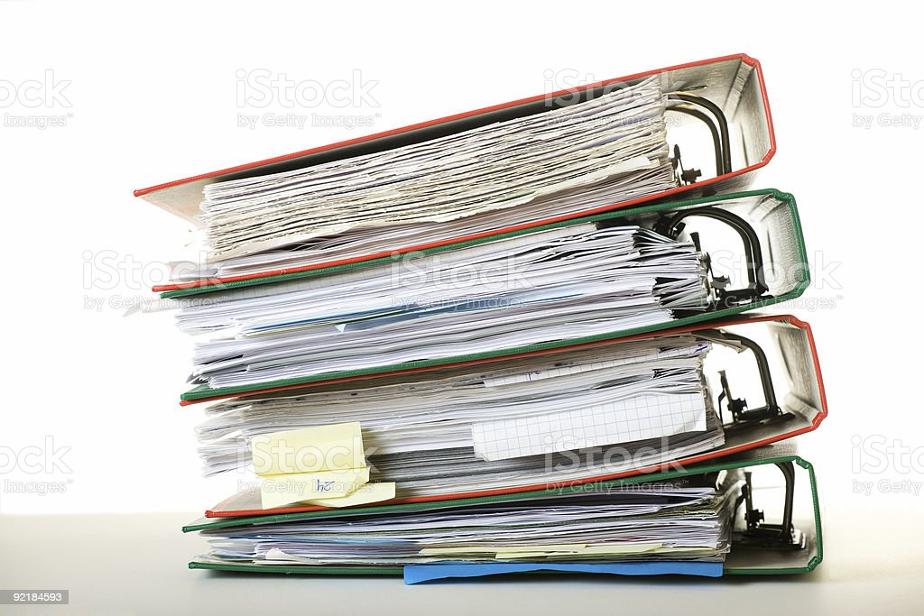 A stack of colorful ring binders full of paperwork royalty-free stock photo