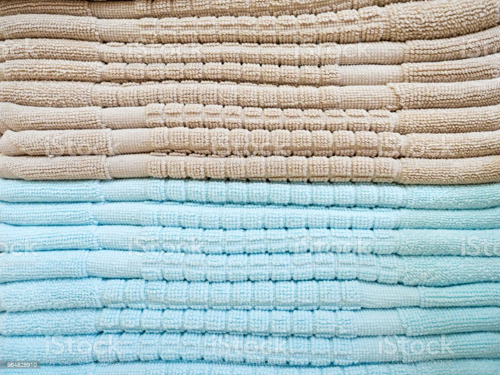 Stack of colorful terry towels folded. Shop Home. Numerous towels stacked and folded on the shelves of a store royalty-free stock photo