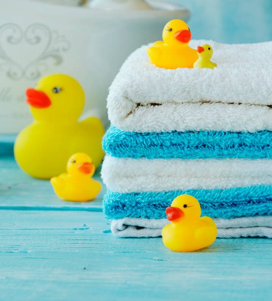 Stack of colorful towels and bath duck on the table picture id649684406?b=1&k=6&m=649684406&s=612x612&w=0&h=vz9fpi ofsyog0w2cx6gsrcu5r mnka7zraslhxfogw=