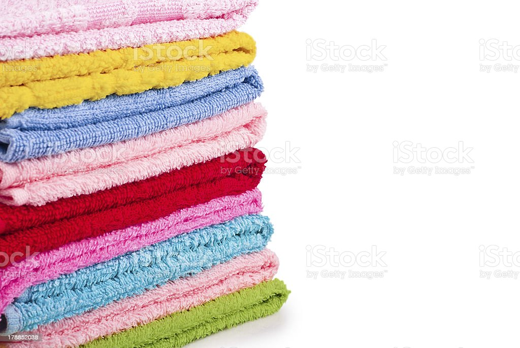 Stack of colorfull towels on white royalty-free stock photo