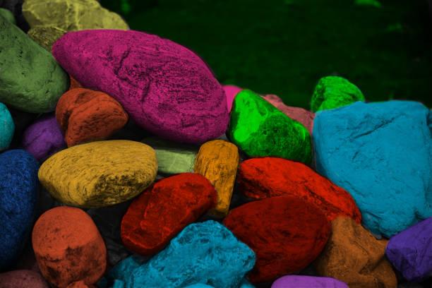Stack of colourful stones around a coastal area photo stock photo