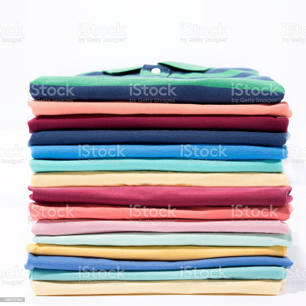 Stack of colourful t-shirt stock photo