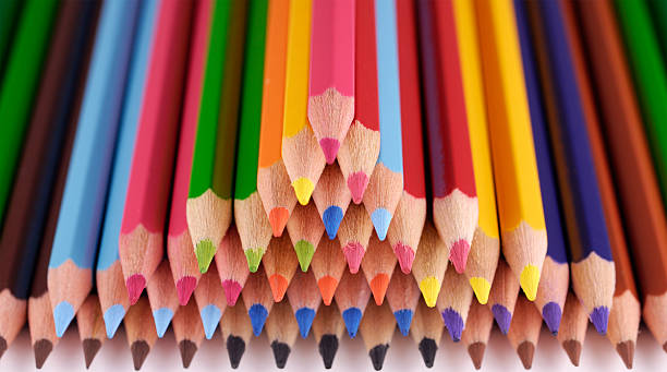 Stack of colouring pencils photographed with shallow depth of field stock photo