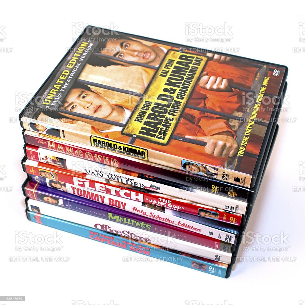 Stack of comedy DVDs isolated on a white background royalty-free stock photo