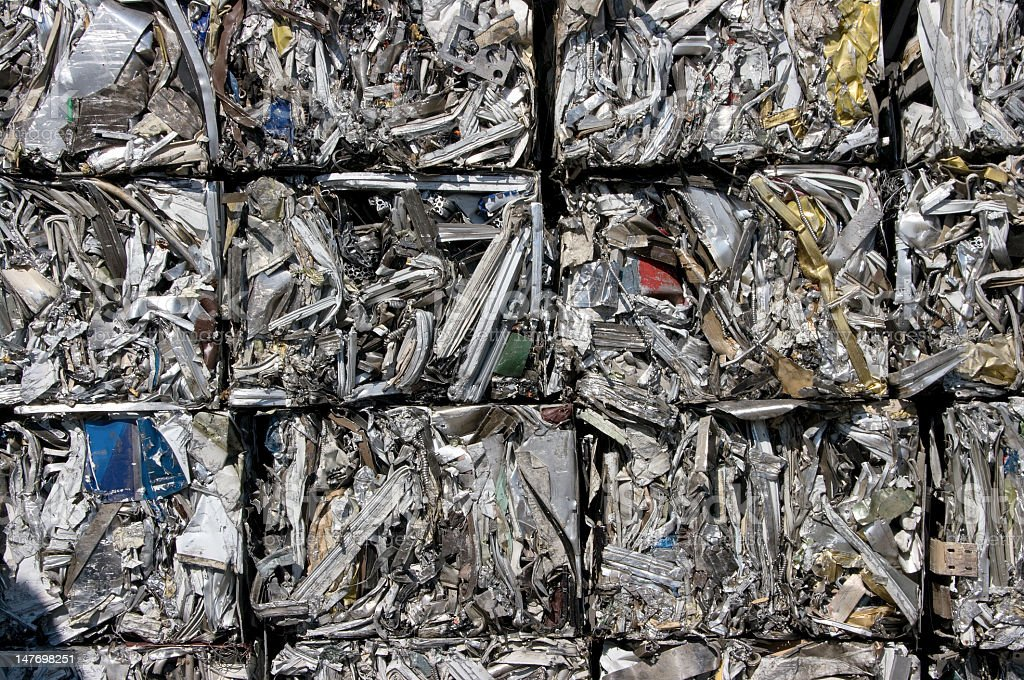 A stack of compact aluminum cubes ready for recycling  stock photo