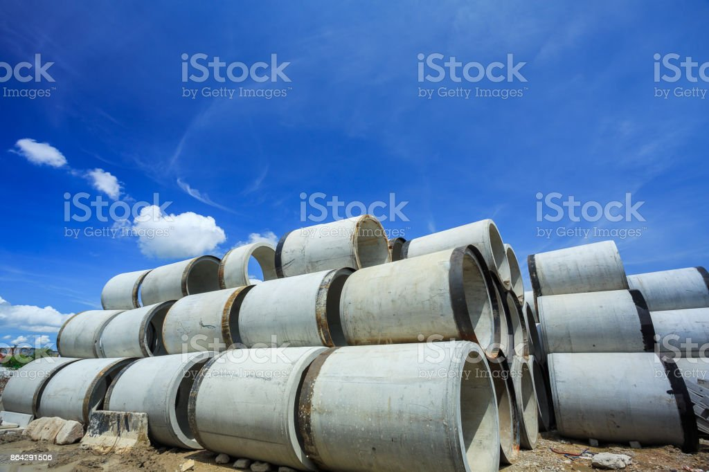 Stack of concrete drainage pipes for wells and water discharges royalty-free stock photo