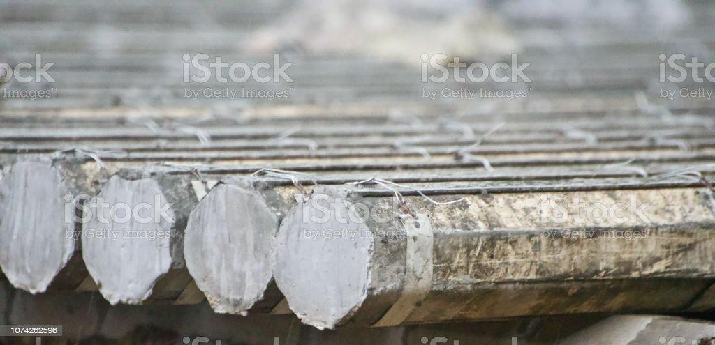 Stack of concrete pillars isolated unique photo stock photo