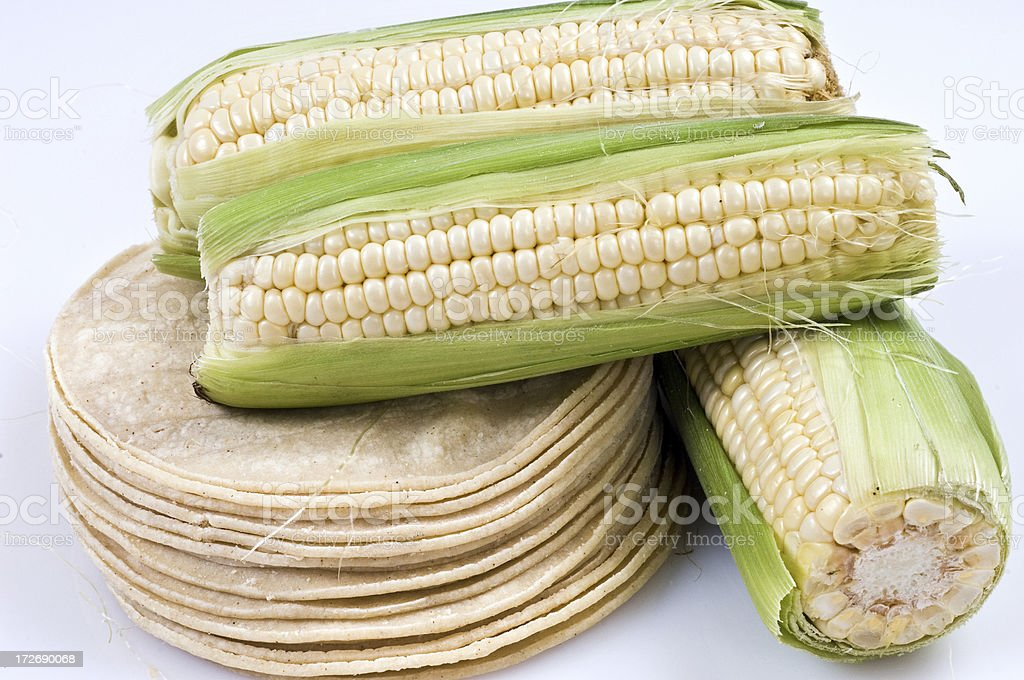 Stack of Corn tortillas and some pieces of corn on the cob stock photo