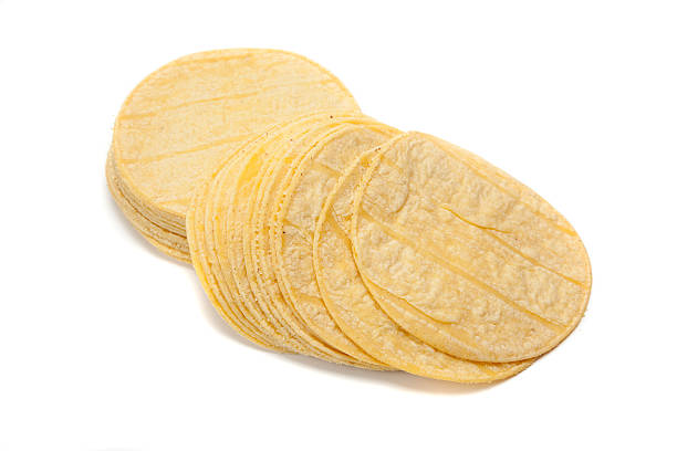 stack of corn tortillas on white - tortilla stock photos and pictures