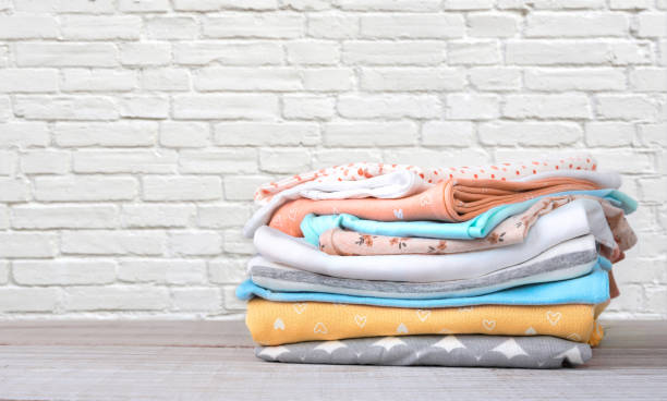 Stack of cotton colorful clothes empty space background. stock photo
