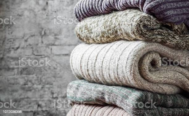 Stack of cozy knitted sweaters on gray wall background picture id1072036398?b=1&k=6&m=1072036398&s=612x612&h=yt97wi1lccrbv041uipjbdv jcfzr94mjg1aitce9g0=