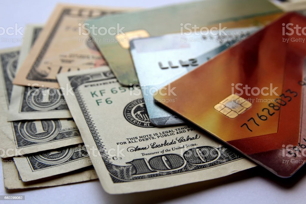 Stack of credit cards and american dollars, close-up view. stock photo