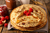 istock stack of crepe with raspberry and chocolate 1199864630