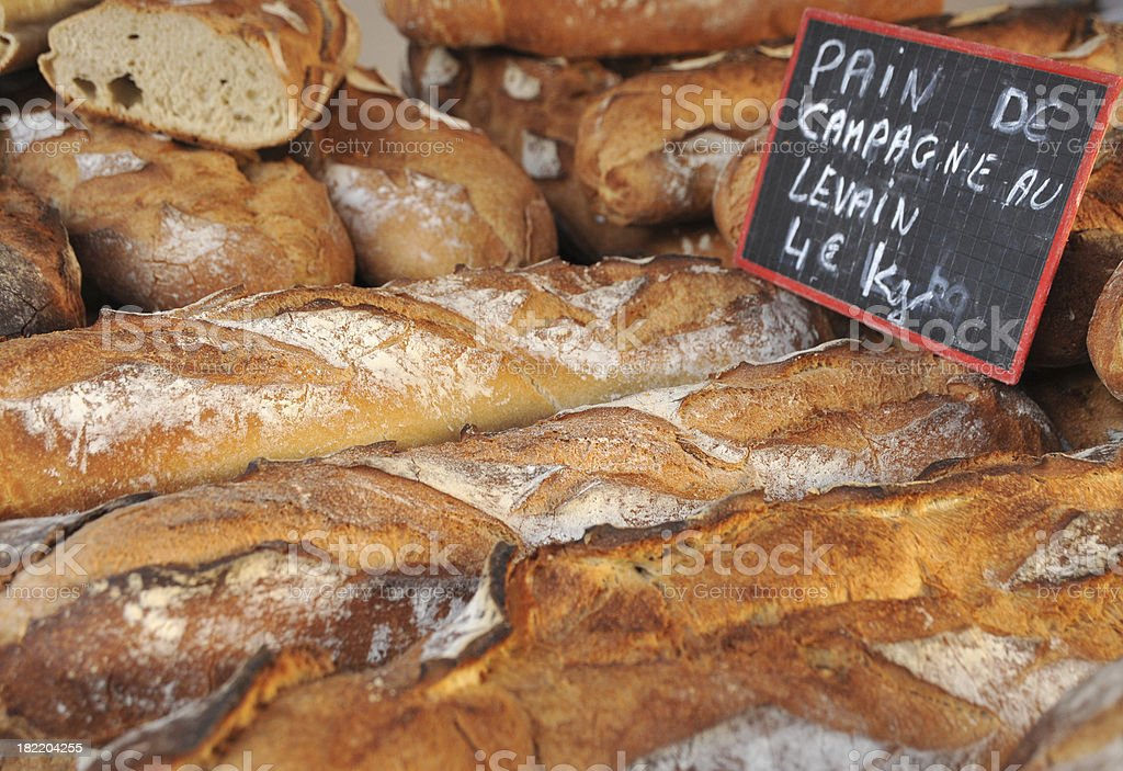 Stack of crusty French bread at the market royalty-free stock photo