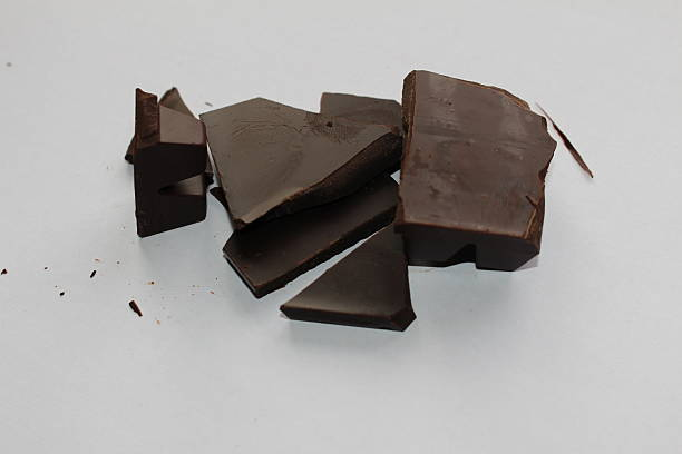 Stack of dark chocolate pieces stock photo