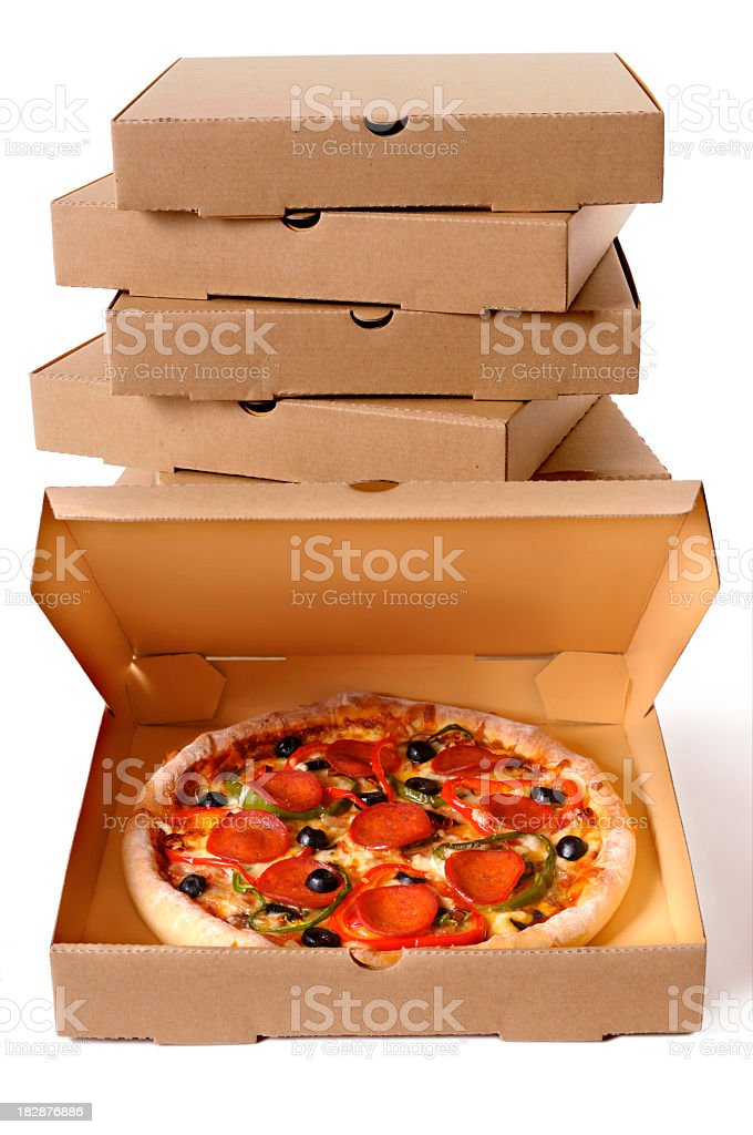 Stack of delivery boxes with a fresh supreme pizza royalty-free stock photo