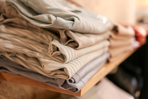 Stack of denim pants on a shelf stock photo