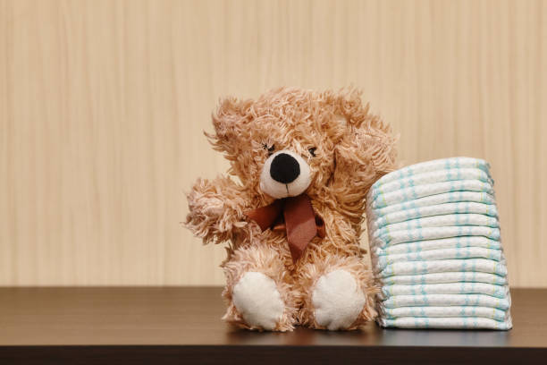 Stack of diapers or nappies with teddy bear picture id652220602?b=1&k=6&m=652220602&s=612x612&w=0&h=wlvmicq rcfn8d6iauefw2wjxjj4gwlc09yugjl5j9u=