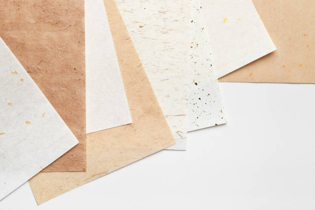Stack of different handmade paper on a white background stock photo