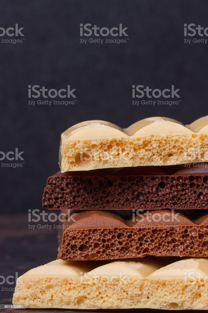 stack of different kind porous chocolate pieces stock photo