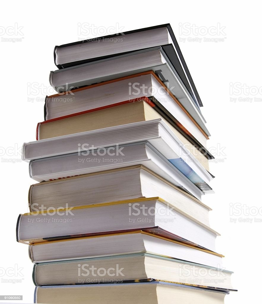 Stack of different kinds of books isolated on white royalty-free stock photo