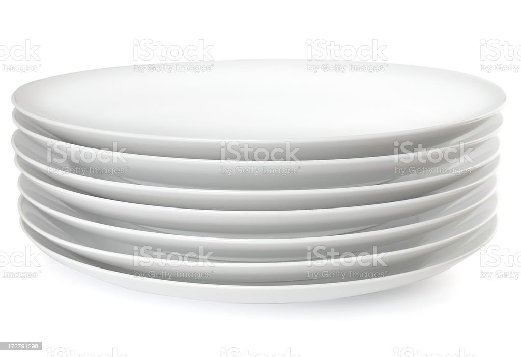 Stack of dinner plates stock photo