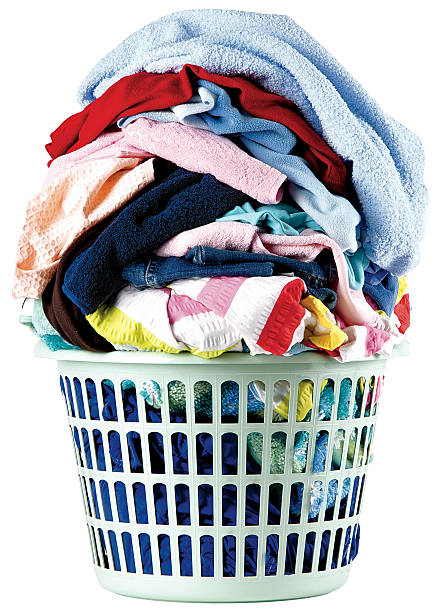 A stack of dirty laundry in a basket laundry in the basket.  laundry basket stock pictures, royalty-free photos & images
